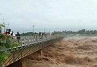 flooding in Mozambique, river bridge
