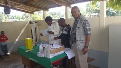 Alberto Mabote (on the right) with the EPI chief for Zambezia (middle) going through the new data collection form with a nurse at a health facility; the information will be used in SELV