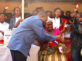 The first child receives Rotavirus vaccine
