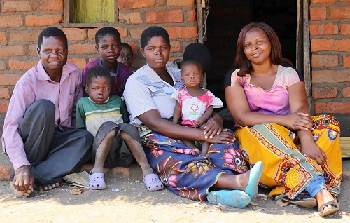 mobile health hotline client Ellena and her family in Malawi